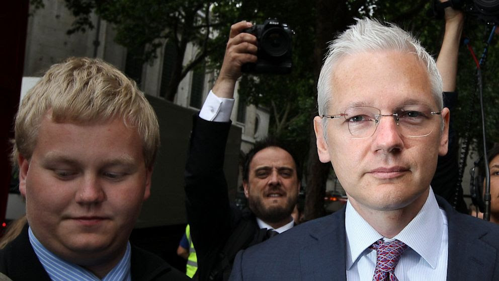 Sigurdur Thordarson, left, walks with WikiLeaks website founder Julian Assange, right, as he arrives at The High Court on July 13, 2011 in London, England.