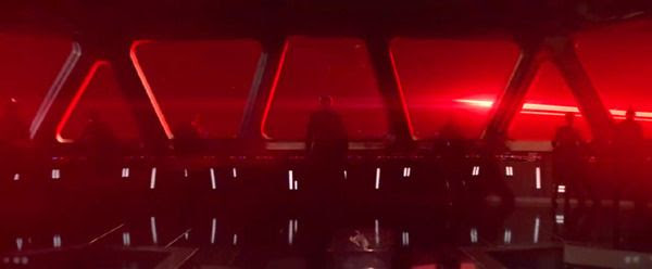 Aboard a Star Destroyer bridge, Kylo Ren (Adam Driver) and First Order officers watch an energy beam—possibly originating from Starkiller Base—shoot off into deep space in STAR WARS: THE FORCE AWAKENS.