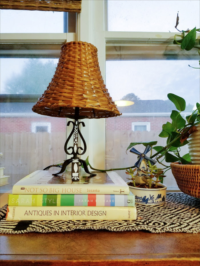 Faux bone inlay lamp atop new and old design books