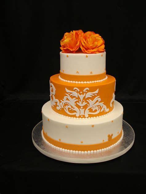 Orange Pow!   Buttercream cake with fondant damask cut out