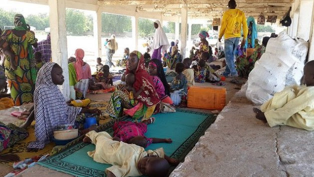 A group of Nigerian refugees rests in the Cameroon town of Mora, in the Far North Region, after fleeing armed attacks by Boko Haram insurgents on Sep. 13, 2014. Credit: UNHCR / D. Mbaoirem