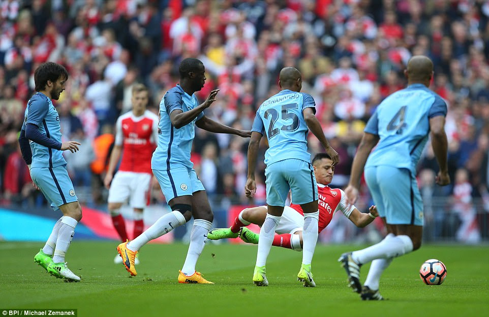 Arsenal star Sanchez got plenty of early attention from City during a furious opening quarter at Wembley