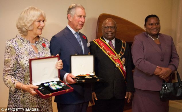 Charles and Camilla posed with Papua New Guinea's Governor General, Sir Michael Ogio and Lady Ogio after receiving their honours