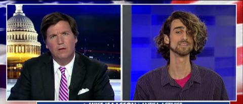 On his show last night, Tucker Carlson battled an Antifa activist over free speech and political violence.