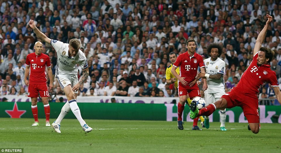 Toni Kroos had a couple of efforts from distance that troubled the Bayern goal, here Mats Hummels makes a vital block