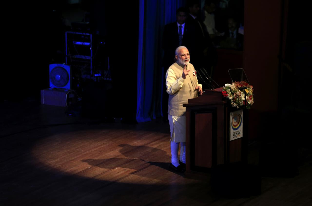 Indian Prime Minister Narendra Modi addresses the gathering at the UN celebration of Vesak ceremony in Colombo, Sri Lanka, Friday, May 12, 2017. During his two-day visit Modi participated in the United Nations celebration of Vesak or the day of birth, enlightenment and death of the Buddha. He also inaugurated a modern hospital for the benefit of tea plantation workers, ancestors of Indian laborers brought by the British from the 18th century.