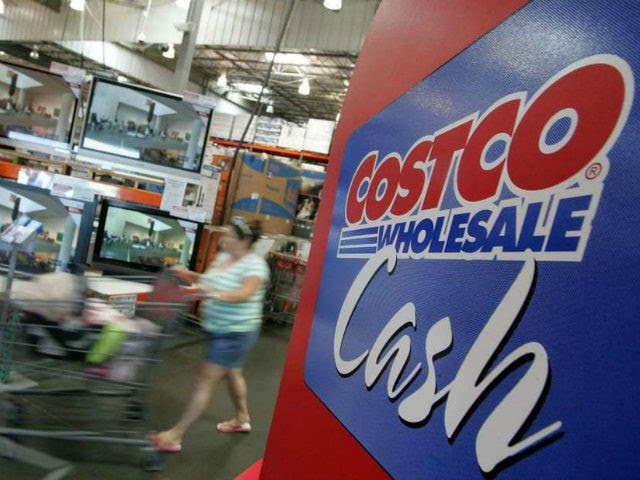 A Costco customer pushes her shopping cart by a display of televisions at a Costco warehouse store July 13, 2007 in Richmond, California. Costco Wholesale Corporation reported a six percent jump for June same store sales fueled by a spike in sales of televisions, jewelry, computers and groceries. (Photo by …