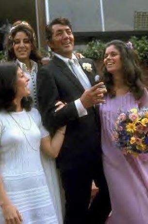 Dean Martin with 3 of his daughters at his 3rd marriage (to Catherine Hawn) 1973 - back is Deana, white dress is Gina, lavender is Claudia.