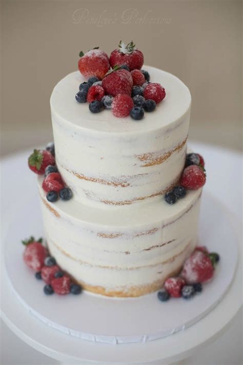 Semi naked cake with frosted berries   Buttercream Wedding