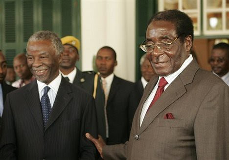 Former South African President Thabo Mbeki along with Zimbabwe President Robert Mugabe. The two leaders had worked on a power-sharing agreement for Zimbabwe. by Pan-African News Wire File Photos