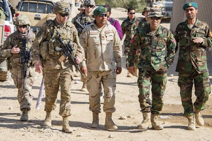 US assures Afghans it will not abandon them after agreeing first step of peace deal with Taliban