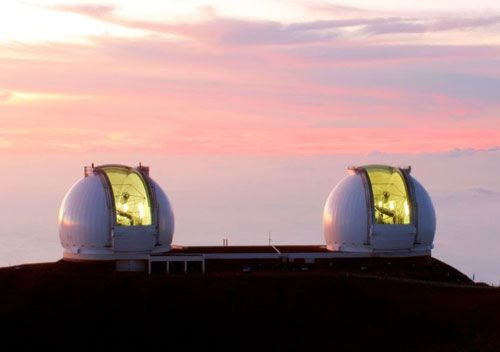As the Sun sets, the twin Keck telescopes prepare for another night of astronomical observations.