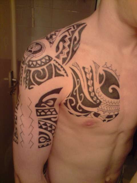 Polynesian Half Sleeve And Chest Tattoo