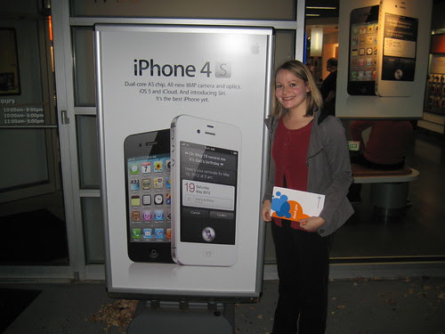 me with iPhone 4S sign outside of AT&T store