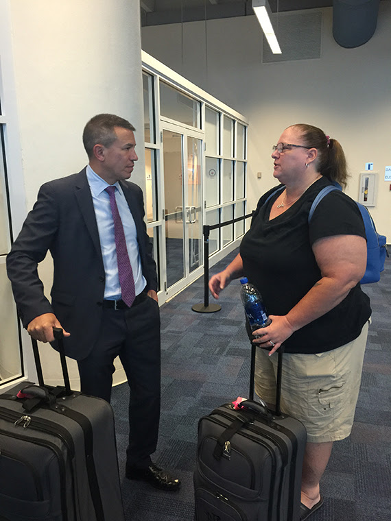 Norwegian Cruise Line CEO Andy Stuart talks with Charlene Woolley, an Atlanta resident on vacation in St. Thomas when Hurricane Irma hit. Photo Credit: Tom Stieghorst