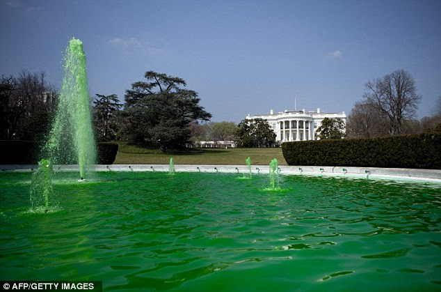 The Green House: In a recently new tradition for the White House, the South Lawn's fountains were dyed green, similar to Chicago's tradition which is the Obama family's hometown