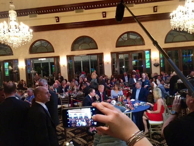A red velvet rope encircled the president's table, separating him from the rest of the attendees.