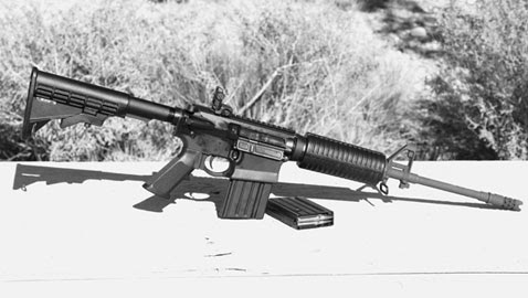 The pre-production GII AP4 introduced at Gunsite rests hot and dirty on a table at Gunsite's Shot Quad Range.  It never malfunctioned.
