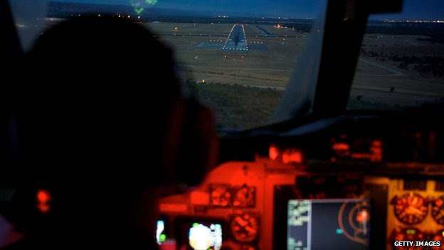 An RAAF AP-3C Orion makes final approach to Pearce airbase after an 11-hour search mission 24/03/2014