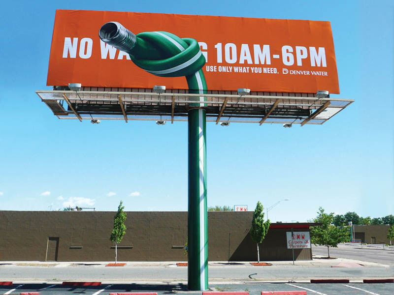 billboard showing hose knotted to conserve water