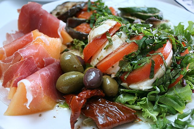 The glorious Antipasto set - parma ham, melon, Caprese salad and grilled vegetables