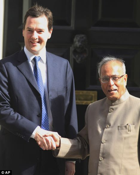 Chancellor of the Exchequer George Osborne, left, shakes hands with India's Finance Minister Pranab Mukherjee on a visit to London in July last year