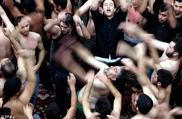 Mourning Iraqi Shiites at the Ashura ceremonies at the Kerbala mosque in Tehran, Iran