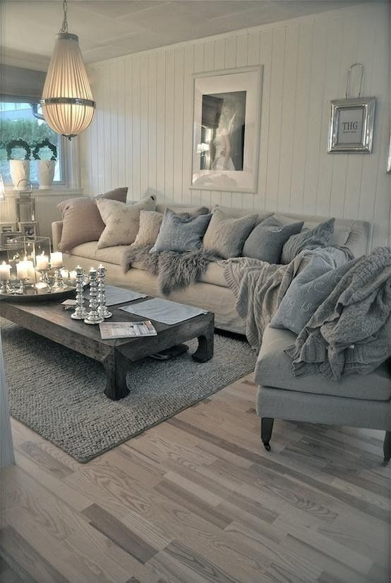 Romantic and shabby chic coastal living room. Who wouldn't want to snuggle into that sofa!