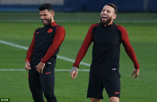 Sergio Aguero and Nicolas Otamendi share a joke as Manchester City trained on Monday
