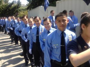Students lined up in police cadet uniforms.