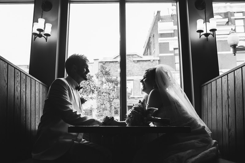 The Bride and Groom hang out and have a beer at Carlyle Brewing Company following their wedding at Court Street United Methodist Church in downtown Rockford Illinois for an Autumn wedding.