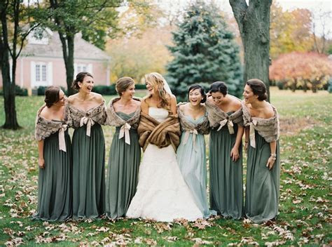 Fur stoles top long, sage green bridesmaids dresses, and