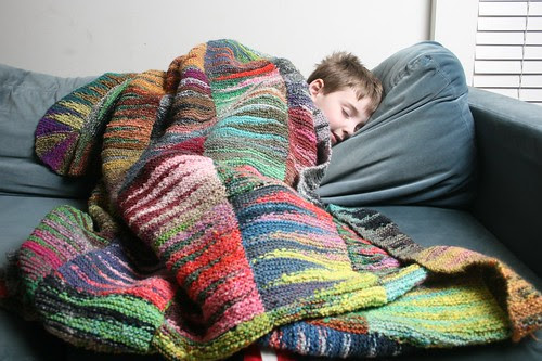 sleeping boy and blanket