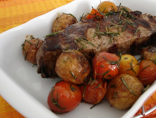 Striploin with golden new potatoes, rosemary and tomatoes
