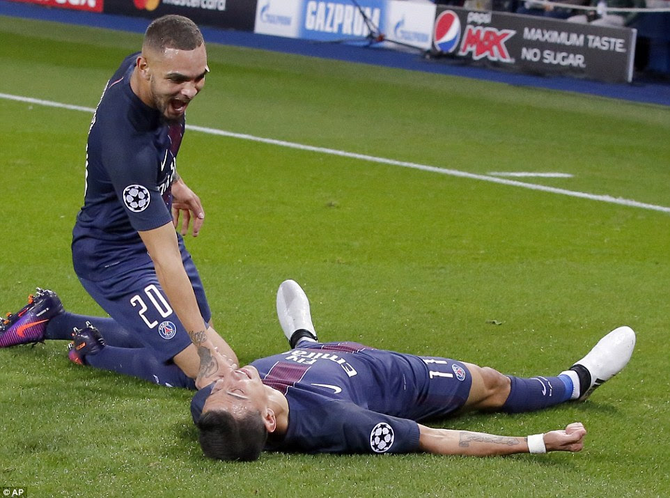 The 28-year-old winger lies on the Parc des Princes turf having fired in a fine strike for the Ligue 1 champions