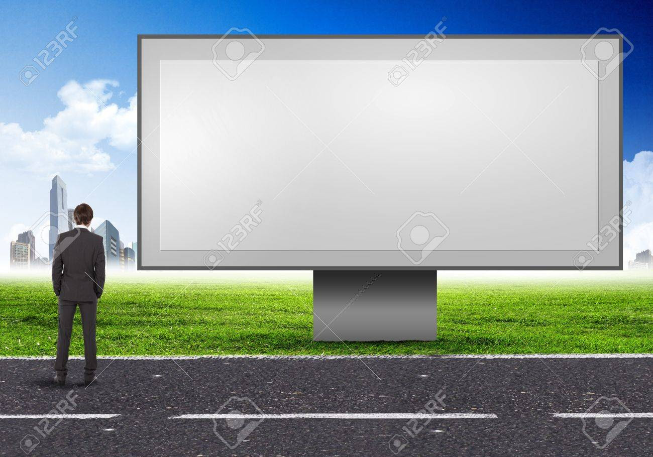 Business Person Standing Near A Blank Billboard Stock Photo ...