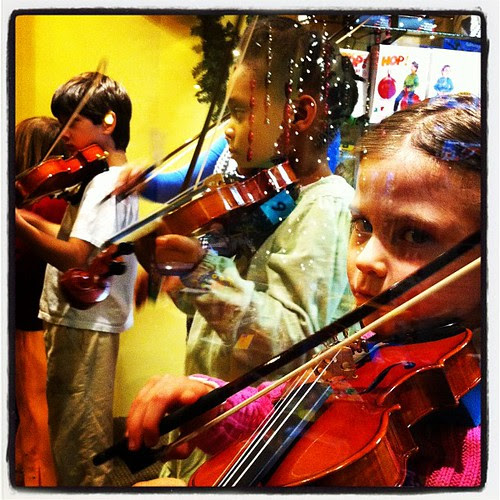Violin Girl in Window by stevegarfield