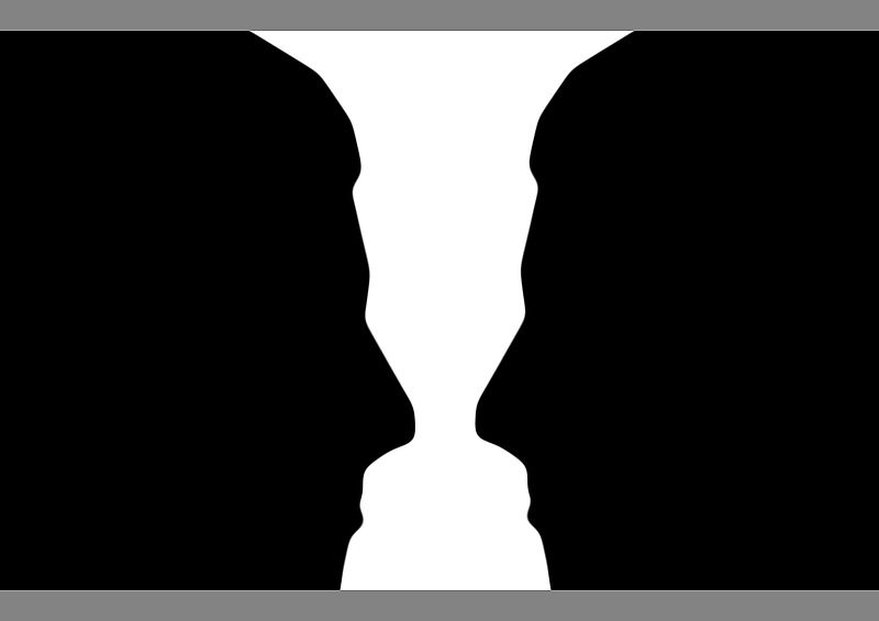 File:Two silhouette profile or a white vase.jpg