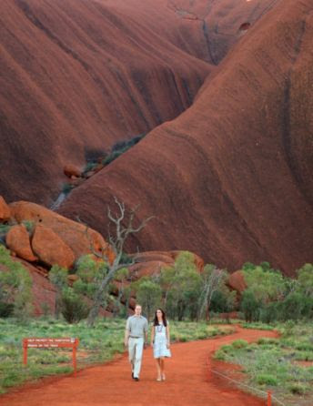 Catherine, Duchess of Cambridge and Prince William, Duke of Cambridge walk down Kuniya Walk at the base of Uluru on April 22, 2014 in Ayers Rock, Australia. The Duke and Duchess of Cambridge are on a three-week tour of Australia and New Zealand, the first official trip overseas with their son, Prince George of Cambridge.