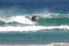 Surfer enjoying wave