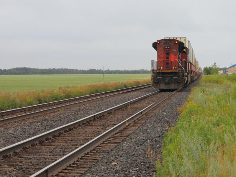 CN 8814 pushing on a train
