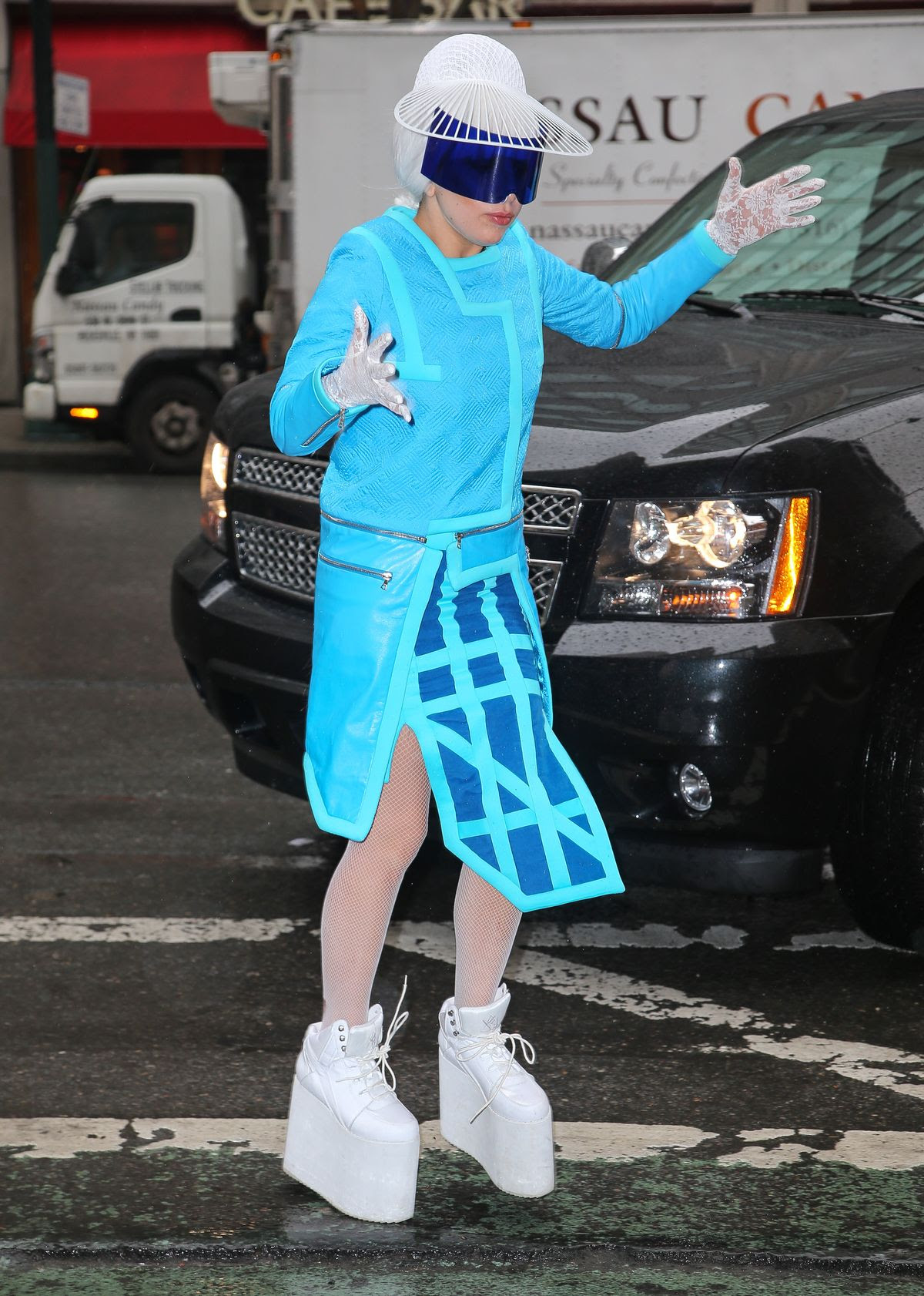 Lady Gaga almost falls in her white platform sneakers while she arrives at the yoga place in New York City
