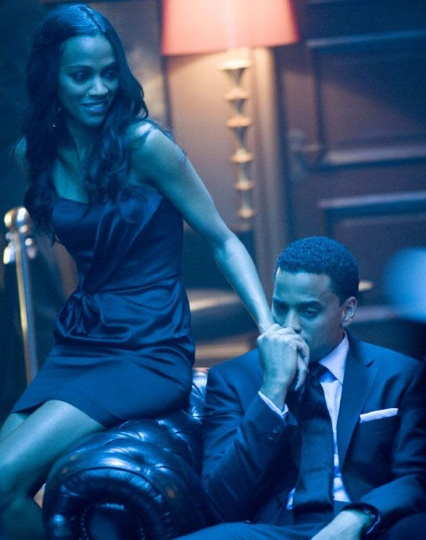 Zoe Saldana and Michael Ealy in TAKERS.