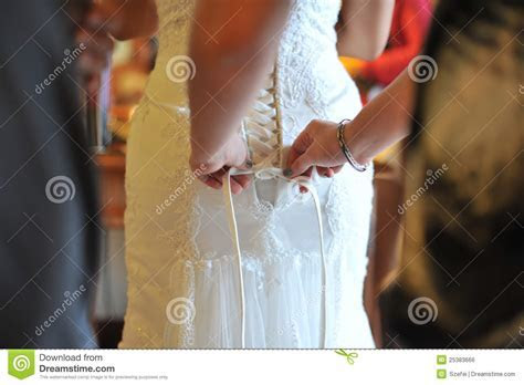 Wedding Gown Being Tied Up Royalty Free Stock Image