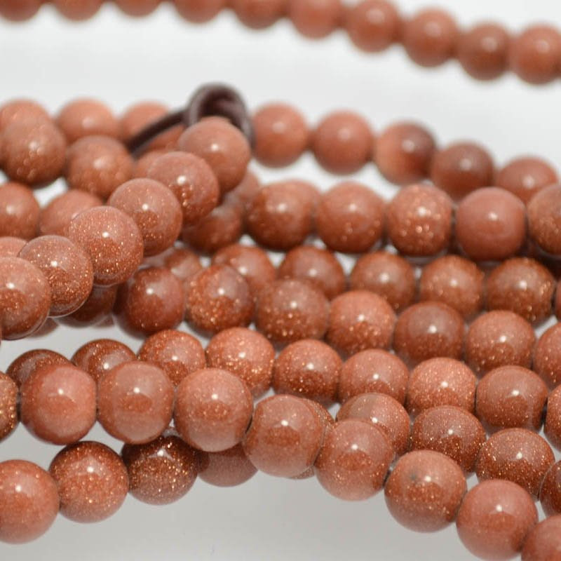 s38323 Stone Beads - 8 mm Round (2 mm Hole) - Goldstone (1)