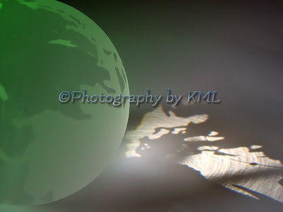 frosted green glass globe with reflection