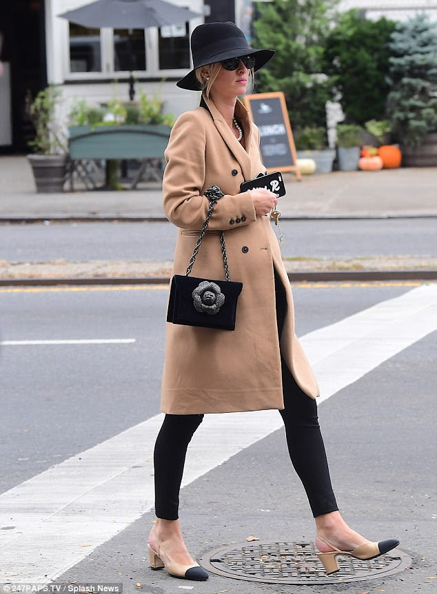 Effortless elegance:The hotel heiress kept the winter chill at bay in an elegant camel wool coat, and accessorized with a stylish black fedora on her head