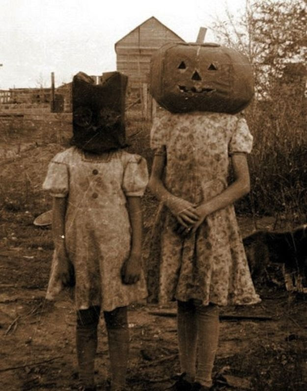 YIKES! The masks alone are giving me heebie-jeebies. | 19 Deeply Horrifying Vintage Halloween Costumes YUP, I'LL TAKE OVER PRICED STORE BOUGHT OVER THESE SCARY ASSED THINGS ANYDAY!!!