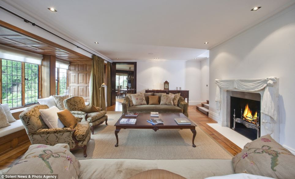 Luxurious: The property is situated at the heart of the exclusive St George's Hill Estate and is on the market for £13,750,000
