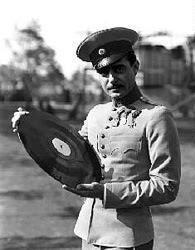Gilbert holding a sound disk.